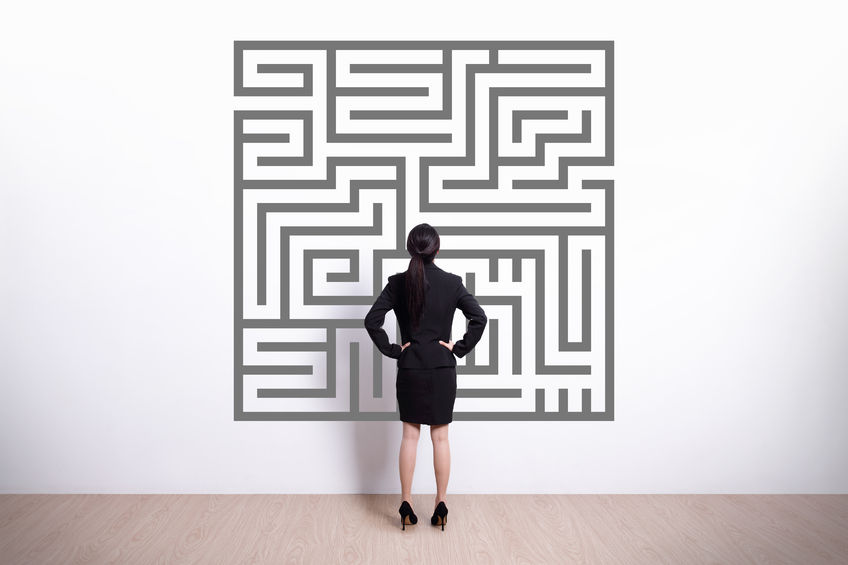 33669765 - back view of business woman look maze with white wall background, asian