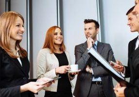 Why You Struggle With Your Elevator Speech, Betsy Kent, Be Visible, Business people talking during conference break; networking